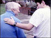 Carer with elderly person