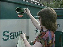 Woman recycling bottles
