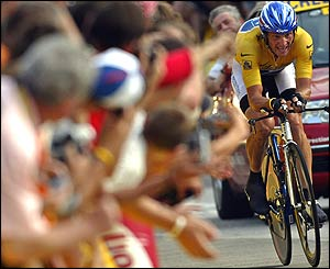 The crowd cheer on legendary rider Lance Armstrong