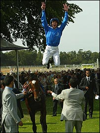 Frankie Dettori performs a flying dismount after winning on Doyen