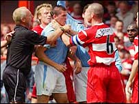 Doncaster Rovers' Mark Albrighton grabs Manchester City's Joey Barton