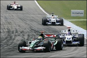 Mark Webber of Jaguar leads Juan Pablo Montoya