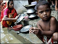 Families in Dhaka floods