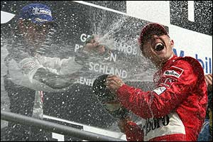 Button and Schumacher on the podium