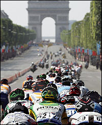 The peloton rides on the Champs-Elysees