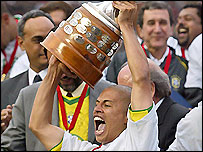 Brazil's Alex lifts the Copa America trophy