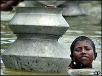 Boy in Dhaka flood