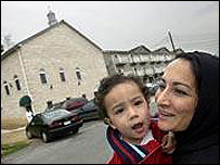 Ms Nomani and her son, Shibli in front of the Islamic Center of Morganto