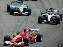Michael Schumacher heads Kimi Raikkonen and Fernando Alonso at the German Grand Prix