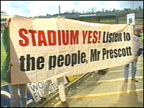 A sign supporting the stadium plans