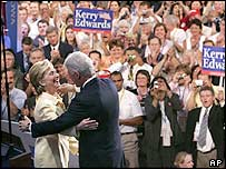 Former US President Bill Clinton hugs his wife, Senator Hillary Rodham Clinton, as she introduces him to the delegates