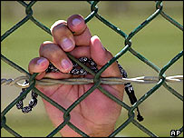 Guantanamo inmate clutches prayer beads