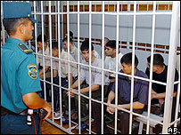 Fifteen accused people sit in the dock during their trial at the Supreme Court of Uzbekistan in Tashkent, 26 July 2004.
