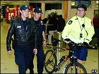 Australian Federal Police patrol Sydney's International Airport terminal (Tuesday, July 27, 2004)