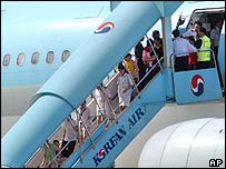 North Korean defectors at the Incheon International Airport in Incheon, west of Seoul, on 28 July 2004