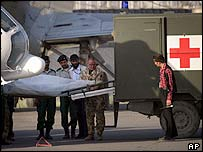 The body of a worker for Medecins Sans Frontieres (MSF) in Afghanistan is unloaded from a helicopter and into an ambulance in Kabul in June 2004