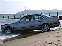 BMW after plunging on to beach