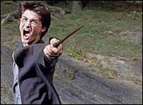 Harry Potter shouting and waving his wand