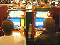 Men at slot machines