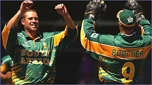 Andrew Hall celebrates a wicket with South African wicketkeeper Mark Boucher