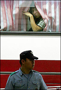 North Korean defector aboard coach after his arrival in the South