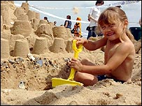 Child with sandcastle