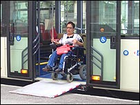 Photo of wheelchair user getting off bus