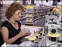 Woman shopping for digital cameras