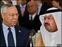 Colin Powell (left) Iraqi President Ghazi al-Yawer and