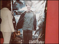 Woman standing in front of a Harry Potter poster in Lagos's new cineplex