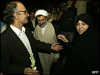 Hashem Aghajari (left) is welcomed home by his wife Zahra Behnoudi