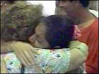 Relatives hug each other at Havana airport