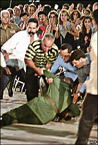 Aides help Mr Castro after his fall