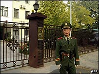 Chinese policeman outside South Korea's embassy in Beijing