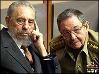 Fidel Castro and his brother Raul (right)