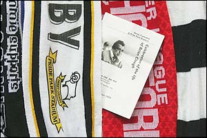 Derby County and Nottingham Forest scarves lie on top of each other