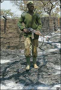 A Ugandan soldier in the Barlonyo camp north of Lira in northern Uganda after a massacre believed to have been committed by the LRA (file picture)
