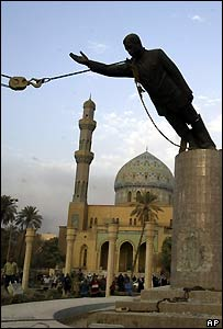 A statue of Saddam is pulled over in Firdus Square, Baghdad