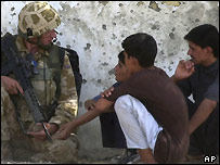 A British soldier talks to local residents