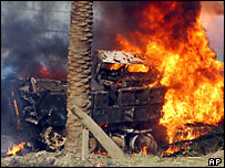 Bradley fighting vehicle burns after being hit in a bombing in Baghdad