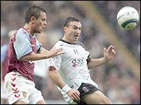 Lee Hendrie (left) keeps a tight rein on Steed Malbranque