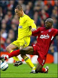 Charlton's Chris Perry and Liverpool's Djibril Cisse
