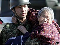 An old lady is rescued after an earthquake in Japan