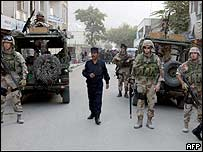 Peacekeepers patrol Chicken St, Kabul, after the blast