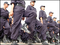New Iraqi police officers parade during a graduation ceremony