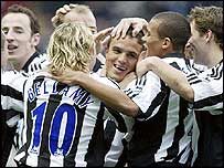 Newcastle celebrate Laurent Robert's goal