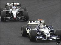 Juan Pablo Montoya held off a charging Kimi Raikkonen to win the Brazilian Grand Prix