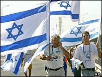 Settlers Avi Farchan, 58, left, and his son Ofer, 24 on a protest walk near the southern Israeli town of Kiryat Malachi