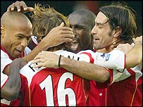 Robert Pires celebrates scoring the last goal of Arsenal's unbeaten run