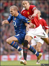 Man Utd defender Rio Ferdinand (right) comes across to tackle Freddie Ljungberg before the two both go down